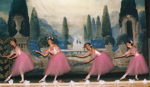 Members of the Detroit Ballet performing on the stage of the west side Dom Polski at the Oczepiny (Unveiling) event presented by the Piast Institute, in conjunction with the West Side Detroit Polish American Historical Society (under the auspices of the West Side Detroit Dom Polski Historical Society) (May 15, 2005). The garden scene backdrop is visible in the background.