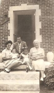 On the porch of 8110 Strathmoor, Detroit. Left to right: Leona Cipkowski, Ted Gomulka, Anna Gomulka, Carol Cipkowski, and Nancy Martin (ca. 1942)