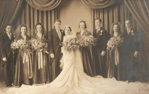"Wedding Portrait of Stanley (""Chip"") Cipkowski and Leona (Gomulka) Cipkowski (September 11, 1937). Sophia Gomulka, third from left; Ted Gomulka, third from right. (Photo: Mazur Studio, Michigan Ave. near Central, Detroit)"